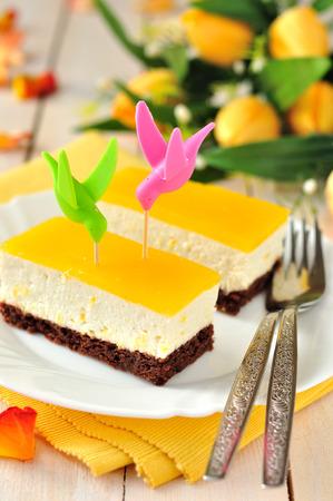 quark: Two pieces of orange mascarpone quark cake (cheesecake)