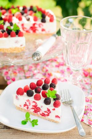 black raspberries: A Piece of No-bake Fresh Raspberry Cheesecake with Red and Black Raspberries and Melissa