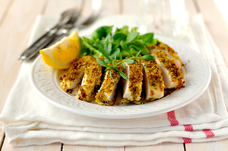 chicken breast: Sliced lemon herb crusted chicken breast