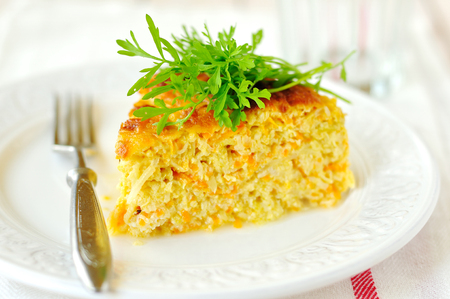 A Slice of Zucchini and Carrot Bake with Rocket, shallow depth of field Stock Photo