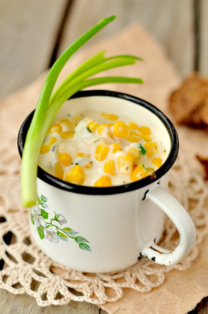 Thick and creamy corn soup with potatoes and greens, copy space for your text 스톡 콘텐츠