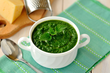 Nettle, cheese and fresh green cream soup 스톡 콘텐츠