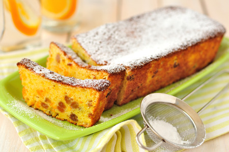 sultanas: Sliced orange cake with sultanas, copy space for your text Stock Photo