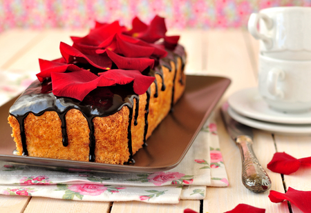 special occasions: Cake loaf with chocolate glaze and rose petals, good for birthday, St. Valentines day and other special occasions.