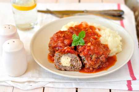 Meat balls stuffed with cheese in tomato sauce 스톡 콘텐츠