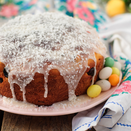 russian easter: Kulitch (Kulich), Russian Easter Bread Topped with Sugar Icing and Dessicated Coconut, Decorated with Easter Eggs Candies