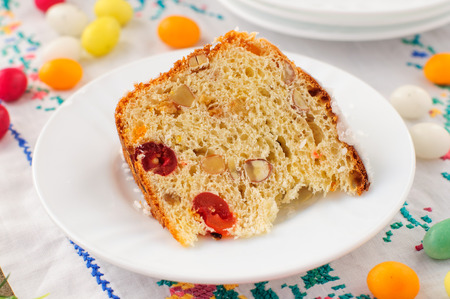 russian easter: A Slice of Kulitch (Kulich), Russian Easter Sweet Bread on Festive Embroidered Table Cloth