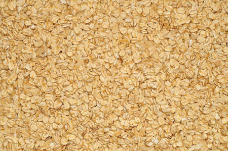 avena en hojuelas: Rolled oats arranged as a background or texture Foto de archivo