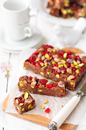 glace: Chocolate Fudge with Glace Cherries, Pistachios and Coconut, copy space for your text, selective focus, shallow dof Stock Photo
