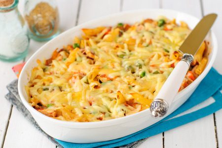bacon baked beans: Macaroni, Pumpkin, Chicken and Cheese Pasta Bake in a White Ceramic Dish Stock Photo