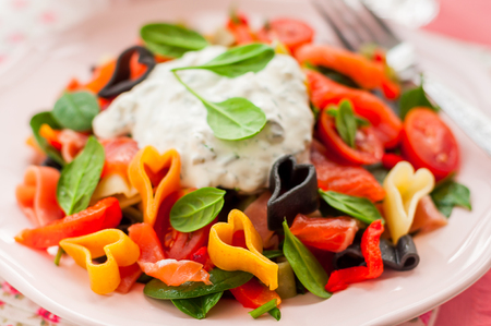 pasta salad: Salmon and Heart Shaped Pasta Salad with Creamy Dressing for Valentines Day, close up Stock Photo