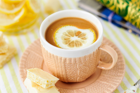 A Cup of Lemon and White Chocolate Coffee Stock Photo