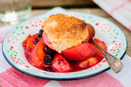 cobbler: A Portion of Peach and Black Raspberry Cobbler, close up