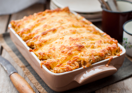 Rustic Style Cheese Crusted Crepe Bake on a Wodden Table