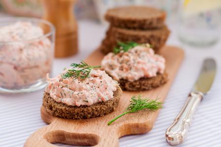 Smoked Salmon, Cream Cheese, Dill and Horseradish Pate on Rye Bread Slices Stock Photo