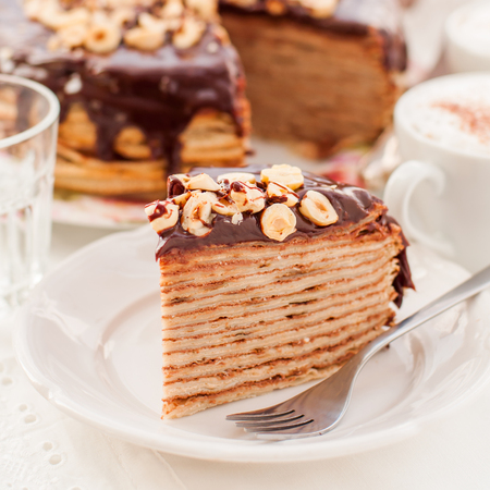 maslenitsa: A Slice of Chocolate, Hazelnut and Cottage Cheese Crepe Cake, Maslenitsa, square Stock Photo