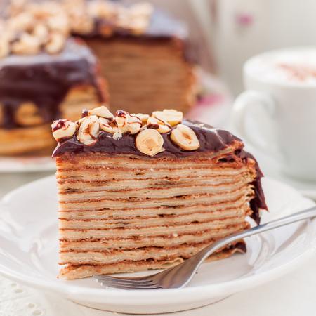 maslenitsa: A Slice of Chocolate, Hazelnut and Cottage Cheese Crepe Cake, Maslenitsa, close up, square Stock Photo