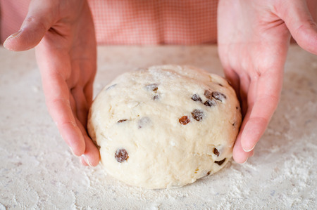 cake balls: Making Sweet Raisin Dough, Hands Dusting Dough Ball with Flour Stock Photo