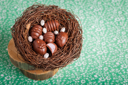 filling in: Easter Egg Shaped Chocolate Candies with Marshmallow Filling in a Nest Stock Photo