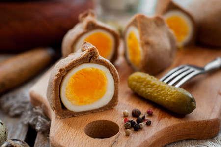 hard boiled: Kokurki, Rye Dough Wrapped Hard Boiled Eggs with Pickles Stock Photo