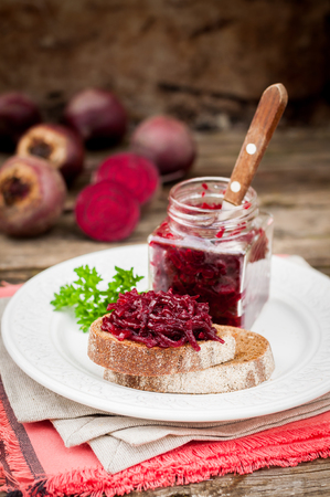 Marinated Beetroot Relish Preserves on Rye Toast, copy space for your text Stock Photo