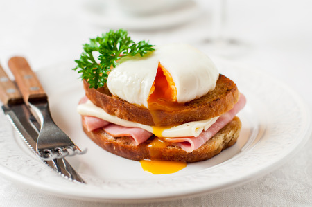 Croque madame, French Toast with Poached Egg, Ham and Cheese, copy space for your text