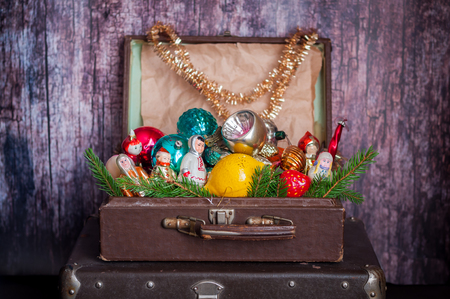 old fashioned christmas: Retro Style Leather Suitcases with Old Fashioned Christmas Tree Decorations