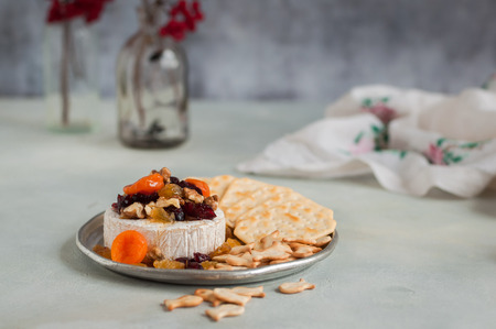 sultanas: Dried Fruit (Apricots, Cranberries and Sultanas), Walnut and Honey Baked Brie with Crackers, copy space for your text Stock Photo
