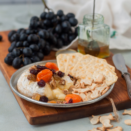 Dried Fruit (Apricots, Cranberries and Sultanas), Walnut and Honey Baked Brie with Crackers and Grapes, square
