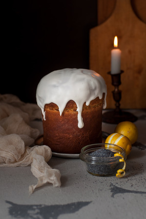easter candle is burning: Kulich, Russian Easter Bread with Poppy Seed and Lemon Zest, copy space for your text Stock Photo