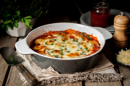 Baked Stuffed Conchiglioni with Tomato Sauce, rustic style 스톡 콘텐츠