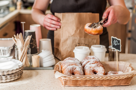 Doughnut Store Counter, Donuts with Icing Sugar in a Display Basket