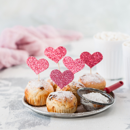 Valentine Sultana Cupcakes Dusted with Icing Sugar Decorated with Pink Glitter Hearts