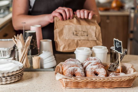 Doughnut Store Counter, Donuts with Icing Sugar in a Display Basket, copy space for your text