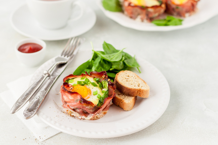 Baked Bacon and Egg Cups with Spinach, Cheese and Spring Onion, copy space for your text Stock Photo