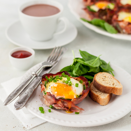 Baked Bacon and Egg Cups with Spinach, Cheese and Spring Onion, square Stock Photo