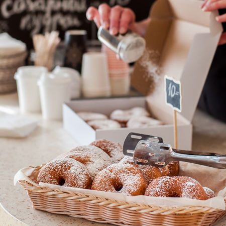 Doughnut Store Counter, Donuts with Icing Sugar in a Display Basket, square