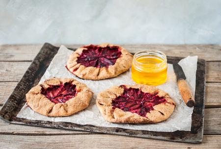 Rustic Wholemeal and Brown Sugar Plum Galettes with Honey, copy space for your text