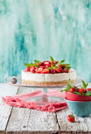 No Bake Strawberry Cheesecake Decorated with Fresh Berries and Mint, copy space for your text