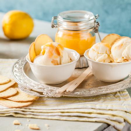 Lemon Curd Swirl Ice Cream with Crackers, square Stock Photo