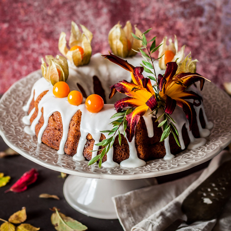 Autumn Harvest Banana Bundt Cake Decorated with Flowers and Physalis, Leaf Fall, square Stock Photo