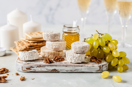 Christmas Cheese Platter, Variety of French Cheeses, Green Grapes, Walnuts, Honey and Crackers Reklamní fotografie