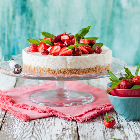No Bake Strawberry Cheesecake Decorated with Fresh Berries and Mint, square Stock Photo