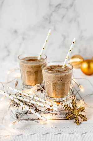 Two Glasses of Date Milkshake with Cinnamon, Christmas Atmosphere, copy space for your text