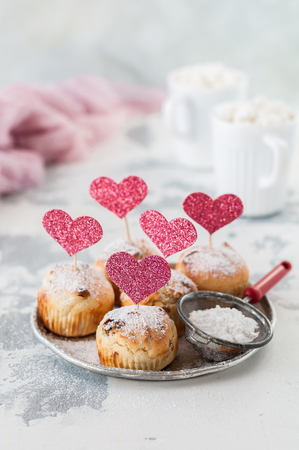 Valentine Sultana Cupcakes Dusted with Icing Sugar Decorated with Pink Glitter Hearts, copy space for your text