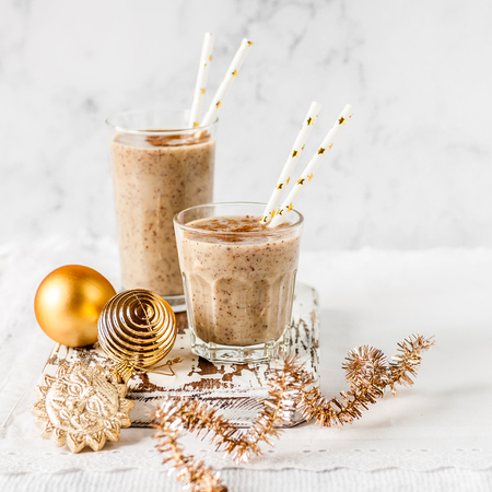 Two Glasses of Date Milkshake with Cinnamon, Christmas Atmosphere, square