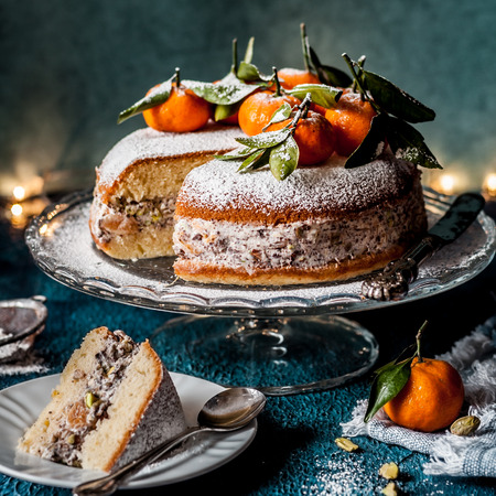 Sliced Ricotta, Pistachio, Chocolate and Tangerine Cake, square Stock Photo