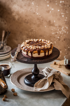 Snickers Chocolate, Caramel, Nougat and Peanut Layered Cake, copy space for your text