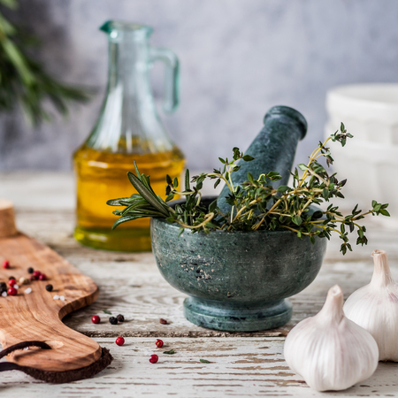 Herbs and Spices, Mortar and Pestle, Thyme, Posemary, Olive Oil, Salt Crystals and Whole Peppercorns, square