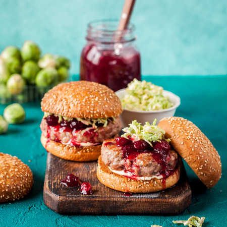 Turkey Burger with Cranberry Sauce and Brussels Sprout Coleslaw, Turquiose Background, square Stock Photo
